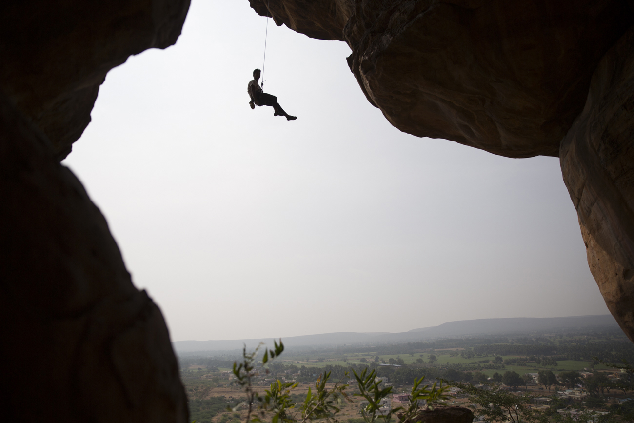 A climber seen at a famous climbing area in Badami, Karnataka.