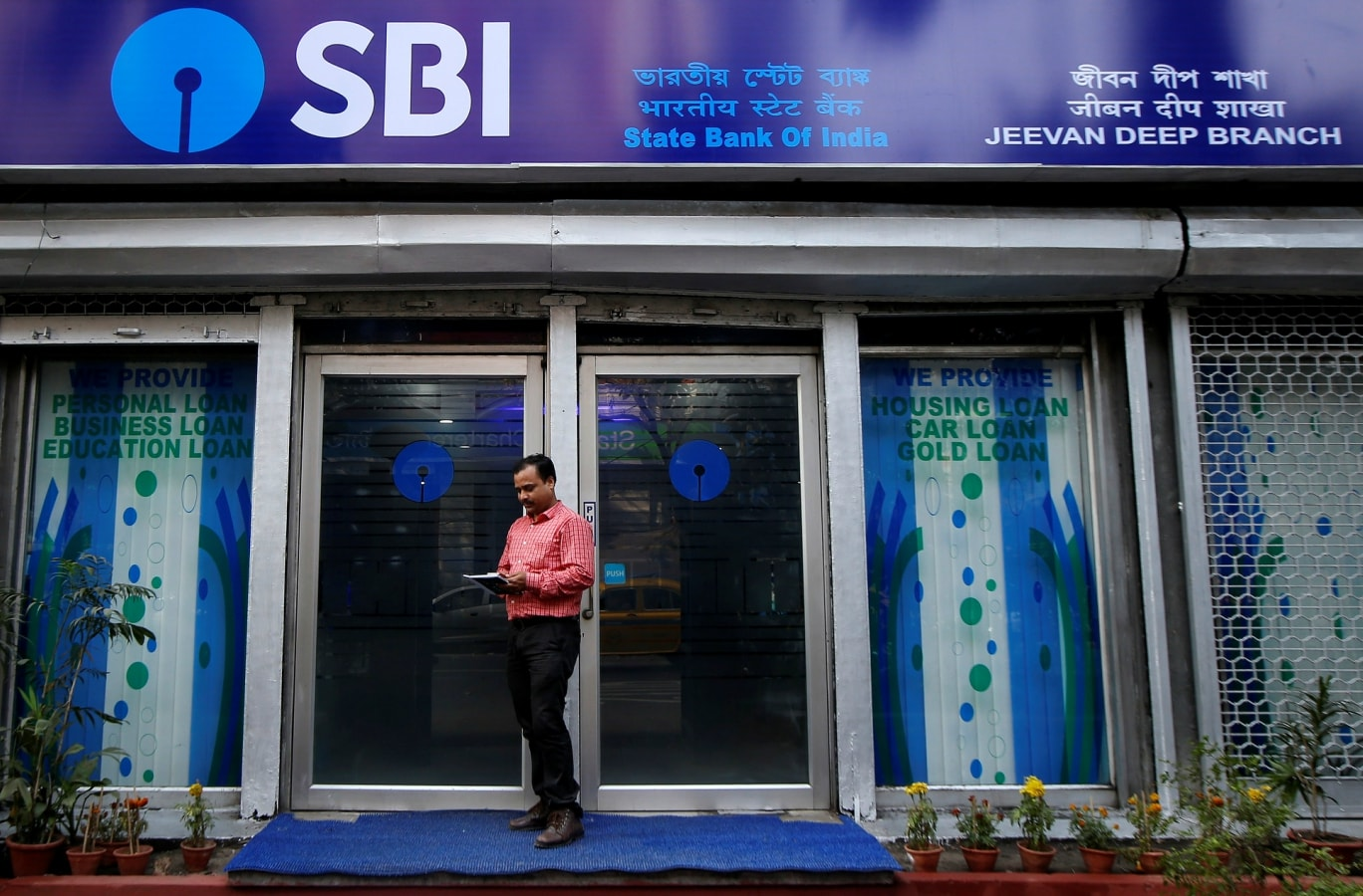 State Bank of India: Better asset quality and a 100 bps dip in credit cost helped the largest lender report a net income of Rs 838 crore for the March quarter as against a net loss of Rs 7,718 crore a year ago, and also guide towards sunnier days. The bank also said it is planning to list general insurance and credit card business in FY20. (Image: Reuters)