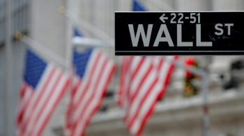 Wall Street flat as trade deal optimism wanes, earnings in focus
