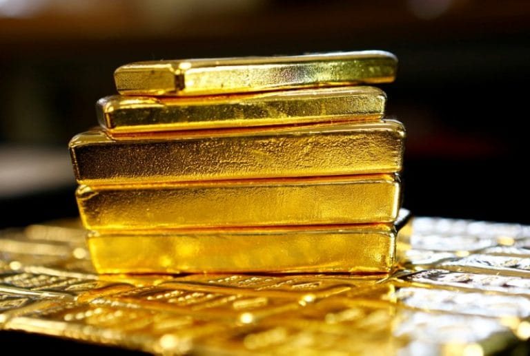 Gold prices crawl up on steady dollar