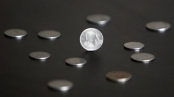 Rupee opens 15 paise higher at 71.09 a dollar, bond yields rise