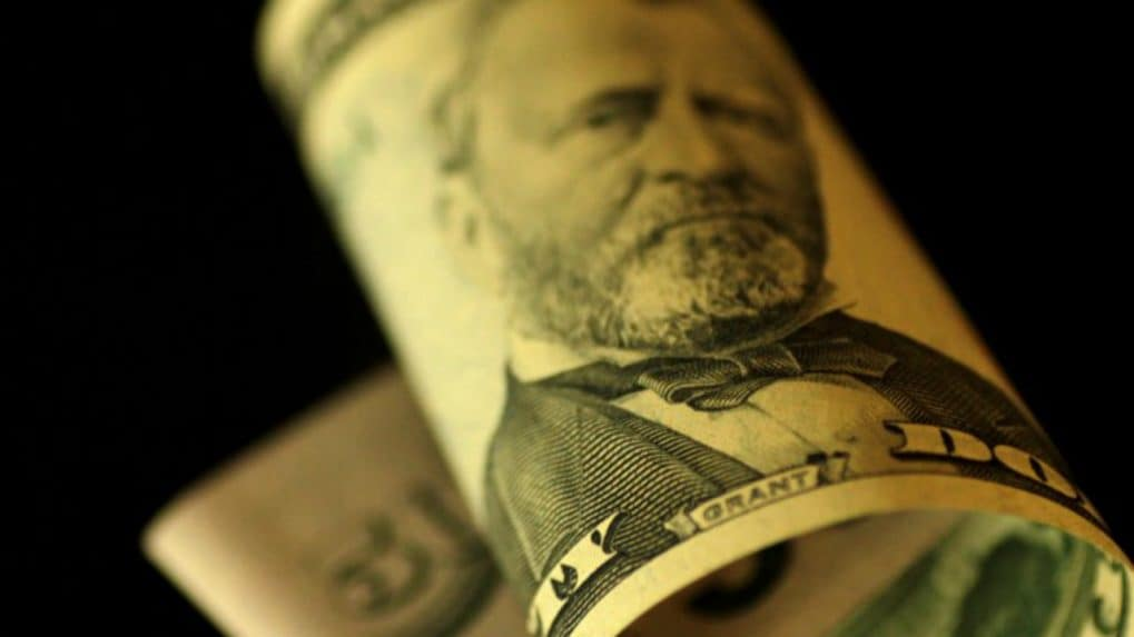 US dollar, stocks climb in relief rally over trade spat