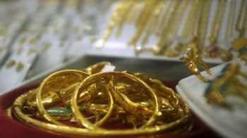 Gold rate today: Yellow metal trades flat near Rs 49,100 per 10 grams; experts suggest buy on dips