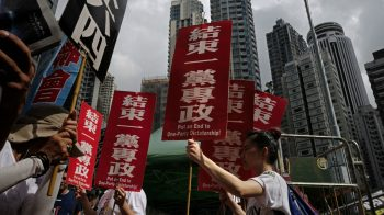 Protesters march in Hong Kong, ahead of the 29th Tiananmen Square anniversary