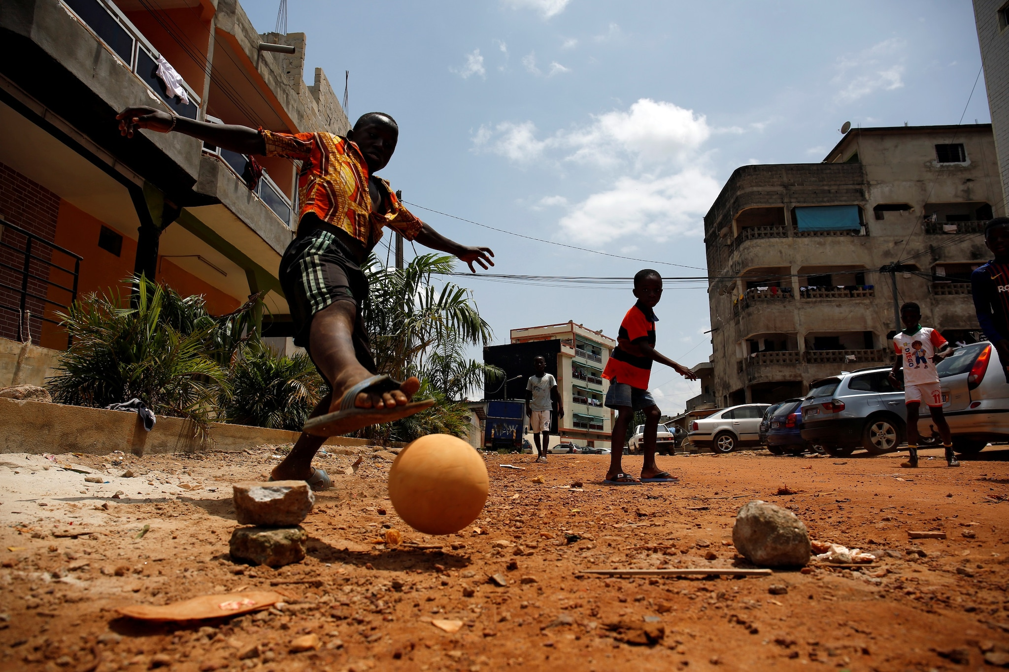 Remi Bamba scores a goal during a football match in a street of a neighborhood in Abidjan, Ivory Coast May 21, 2018. Remi said
