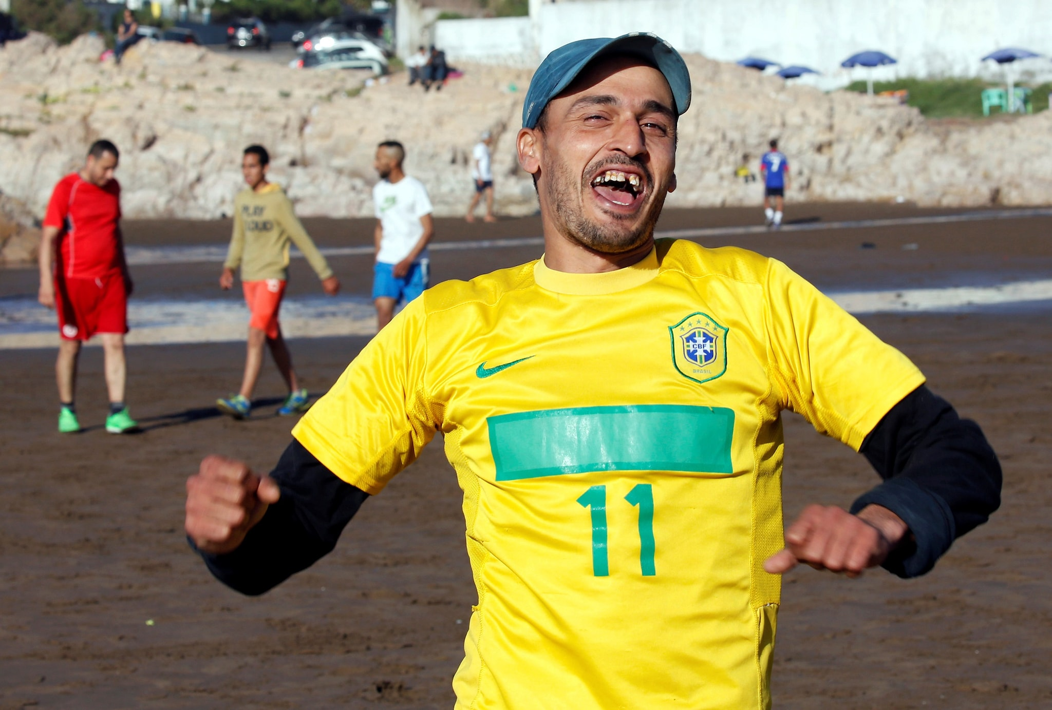 A soccer player celebrates scoring a goal on a beach in Casablanca, Morocco April 29, 2018. REUTERS/Youssef Boudlal/Files