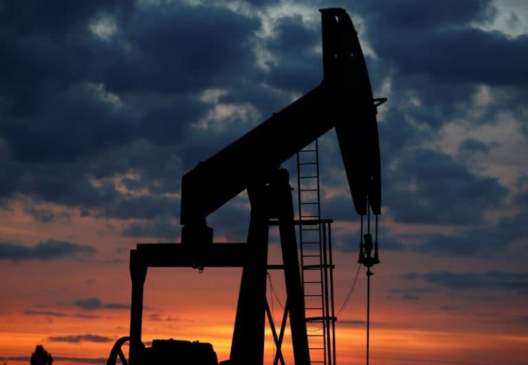 Oil prices fall as US crude production hits another record