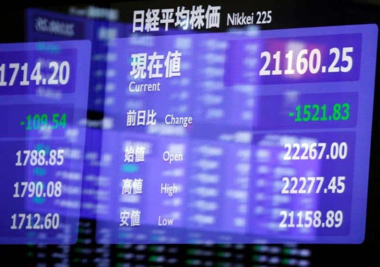 Asian stocks slide as bond markets send recession warning