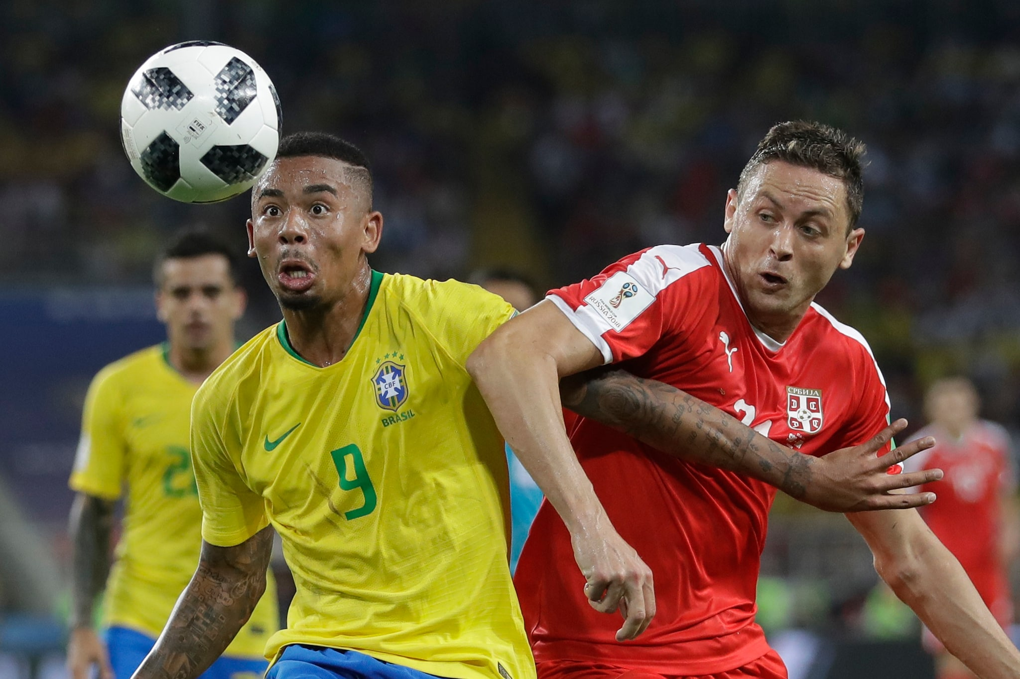 Brazil's Gabriel Jesus, left, fights for the ball with Serbia's Nemanja Matic during the group E match between Serbia and Brazil, at the 2018 soccer World Cup in the Spartak Stadium in Moscow, Russia, Wednesday, June 27, 2018. (AP Photo/Matthias Schrader)