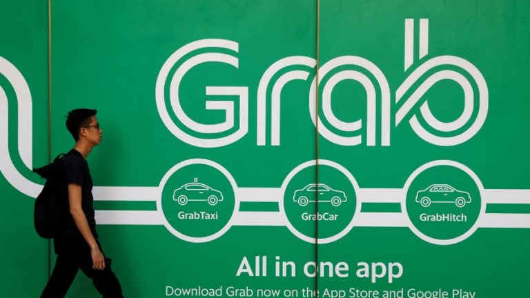 Toyota pumps $1 billion in Grab in auto industry's biggest ride-hailing bet