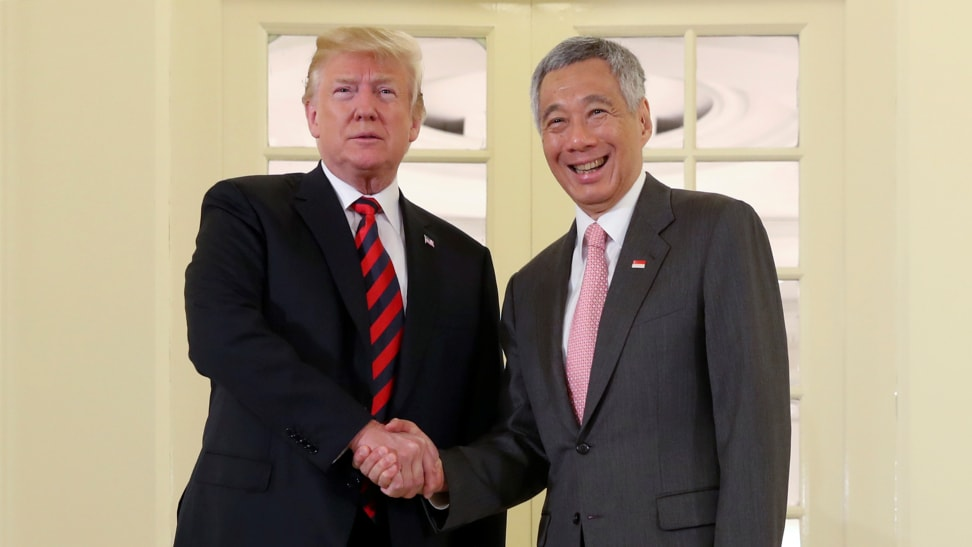 President Donald Trump shakes hands as he meets with Singapore Prime Minister Lee Hsien Loong ahead of a summit with North Korean leader Kim Jong Un, Monday, June 11, 2018, in Singapore.(Source-AP)