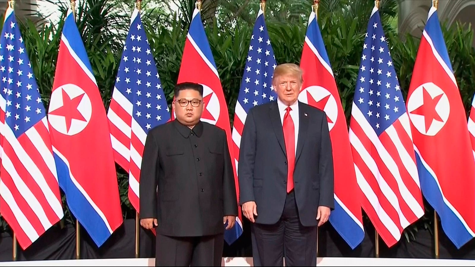 Trump and Kim pose together ahead of their meeting at Capella Hotel in Singapore. (Host Broadcaster Mediacorp Pte Ltd via AP)