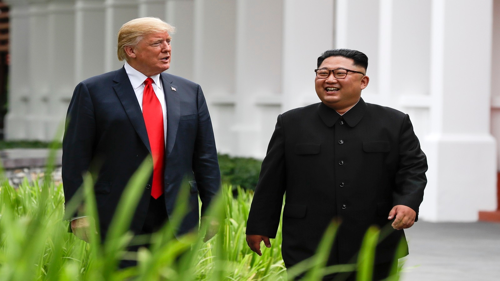 Trump and Kim walk from their lunch at the Capella resort on Sentosa Island. (AP Photo/Evan Vucci)