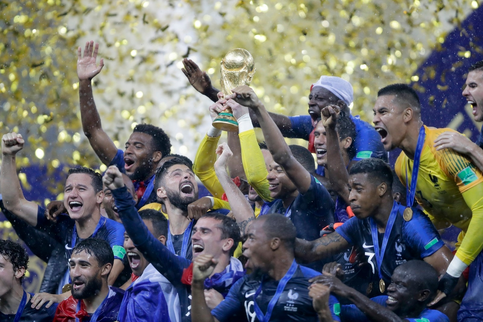 French players celebrare with the trophy after the final match between France and Croatia at the 2018 soccer World Cup in the Luzhniki Stadium in Moscow, Russia, Sunday, July 15, 2018. (AP Photo/Natacha Pisarenko)