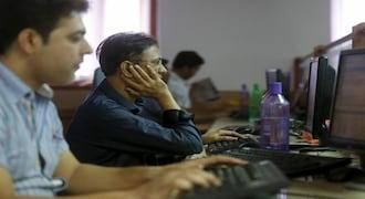 Sensex, Nifty trade flat; Infosys, TCS fall about 2%