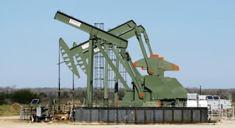 Oil trades near four-year peak ahead of sanctions on Iran
