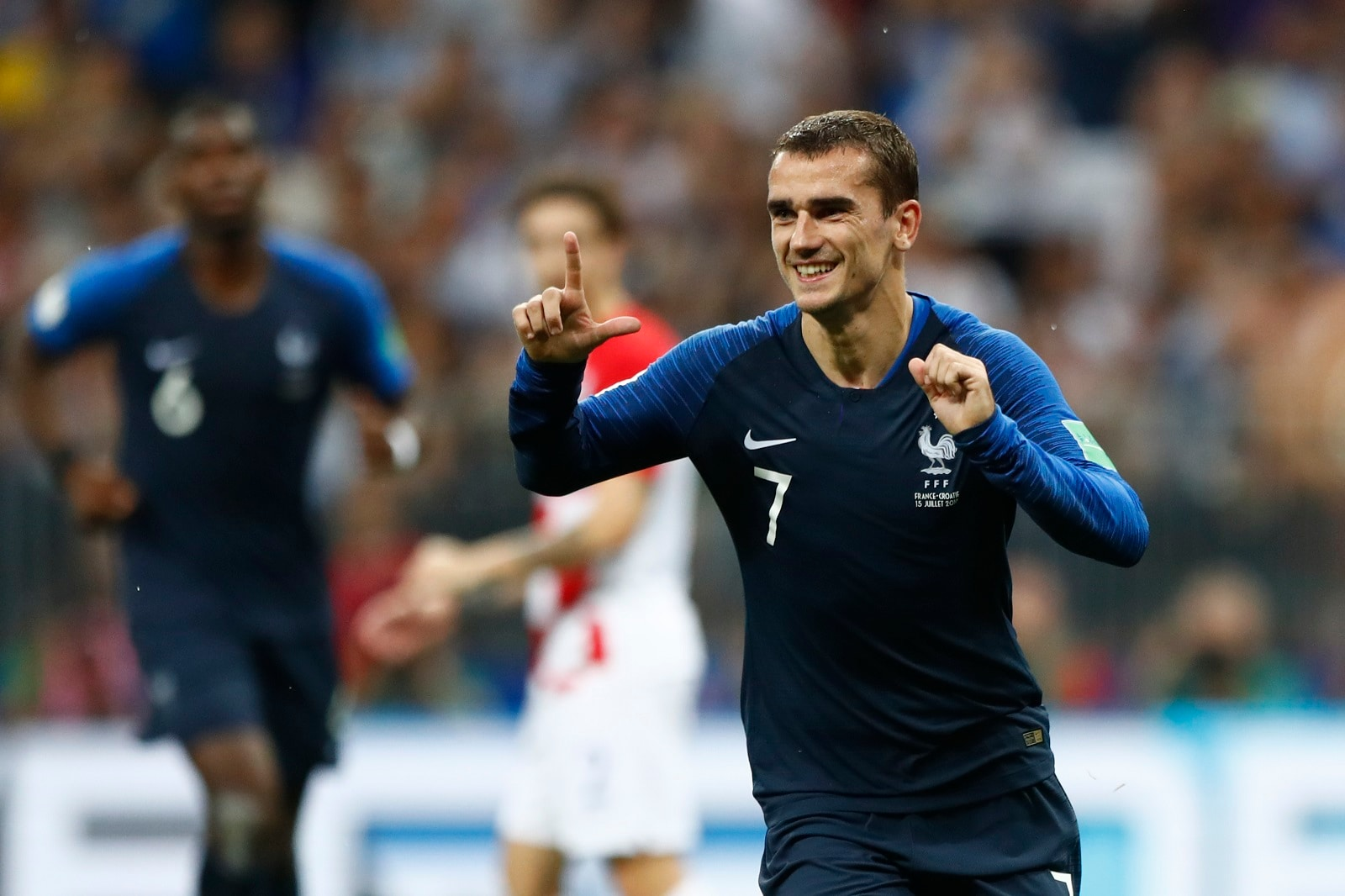 France's Antoine Griezmann, right, celebrates after scoring a penalty kick during the final match between France and Croatia at the 2018 soccer World Cup in the Luzhniki Stadium in Moscow, Russia, Sunday, July 15, 2018. (AP Photo/Matthias Schrader)