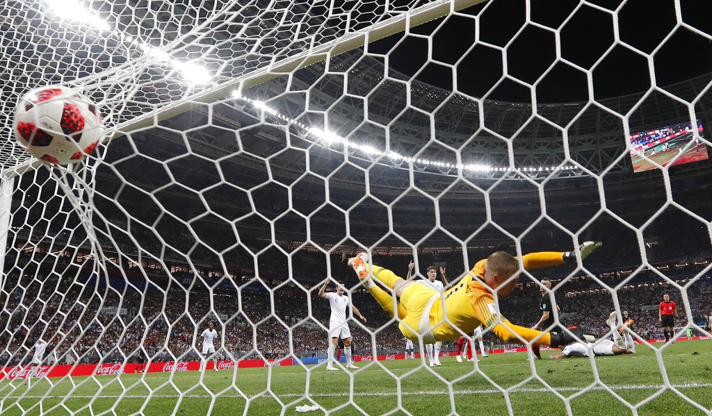 Croatia's Ivan Perisic scores his side's first goal past England goalkeeper Jordan Pickford during the semifinal match between Croatia and England at the 2018 soccer World Cup in the Luzhniki Stadium in Moscow, Russia, Wednesday, July 11, 2018. Source-AP