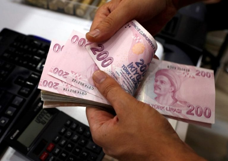 Turkey says has action plan to ease market concerns; lira firms from record low