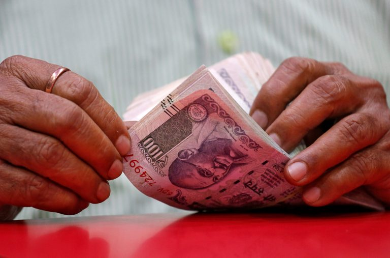 Rupee pares gains, settles flat at 69.36 a US dollar