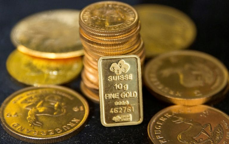 Gold inches down as rate hike views take sheen off
