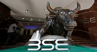 Sensex, Nifty trade higher on positive global cues; Yes Bank, OMCs fall