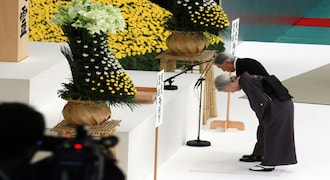 Japan's Emperor Akihito, accompanied by Empress Michiko, bow in front of the main altar during a memorial service for the war dead at Nippon Budokan martial arts hall Wednesday, August 15, 2018, in Tokyo. (AP Photo/Eugene Hoshiko).