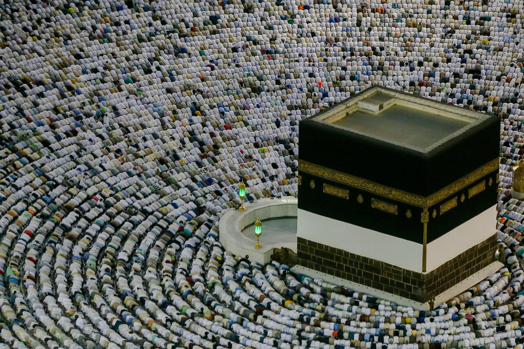 Muslim pilgrims pray at the Grand Mosque, ahead of the annual Hajj pilgrimage in the Muslim holy city of Mecca, Saudi Arabia, Friday, Aug. 17, 2018. The annual Islamic pilgrimage draws millions of visitors each year, making it the largest yearly gathering of people in the world. (AP Photo/Dar Yasin)