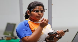 Rahi Jeevan Sarnobat won the gold in Women's 25m pistol event shooting. In the picture, Sarnobat prepares for the final round of the 25m pistol women's shooting event at the 18th Asian Games. (AP Photo/Vincent Thian)
