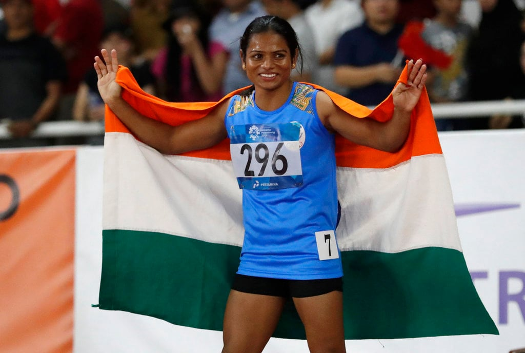 Dutee Chand smashed her own national record in the 100m dash to qualify for the semifinals. Earlier in the morning session, 23-year-old Dutee clocked 11.28 seconds to set a national record while winning her heat in the women's 100m race. She has qualified for the semifinals. Dutee bettered her earlier national record of 11.29 seconds which she set last year in Guwahati. (Picture credits: AP)