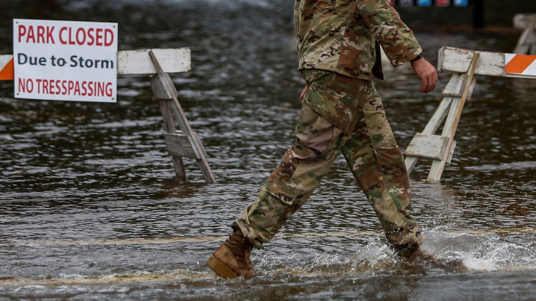 A member of the US Army walks through floodwaters near the Union Point Park Complex as Hurricane Florence comes ashore in New Bern, North Carolina, US. September 13, 2018. REUTERS/Eduardo Munoz