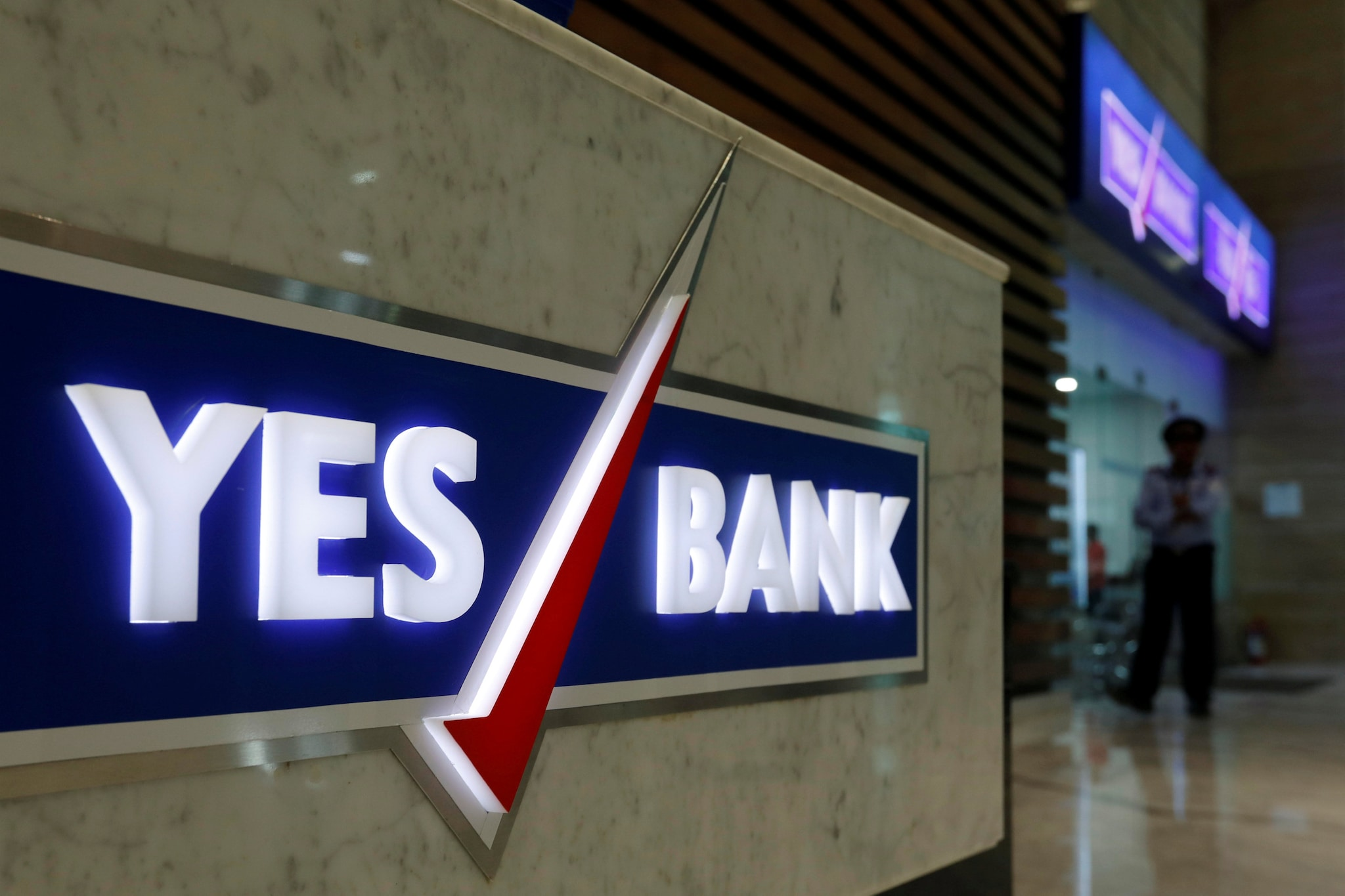 YES Bank: The Reserve Bank of India has imposed a penalty of Rs 11.25 lakh on it for violating money transfer norms. Icra has downgraded the bank's long term rating to AA- from AA. (Image: Reuters)