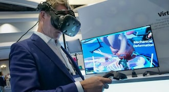 Auto companies look at virtual reality to cut costs