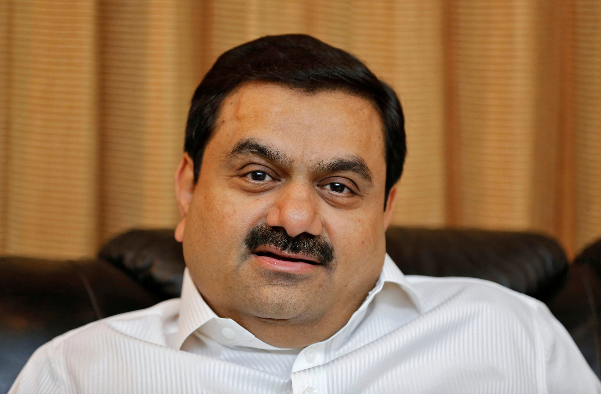 Gautam Adani & family: Net Worth: $11.9 billion.  Adani Group's interests include power generation and transmission, real estate and commodities. Adani's overseas assets include Australia's Abbott Point port and the controversial Carmichael coal mine, billed as one of the world's largest. Adani's son Karan runs listed firm Adani Ports & SEZ, now the family's biggest asset. Adani Group has partnered Swedish defence firm Saab to make Gripen fighter jets in India.