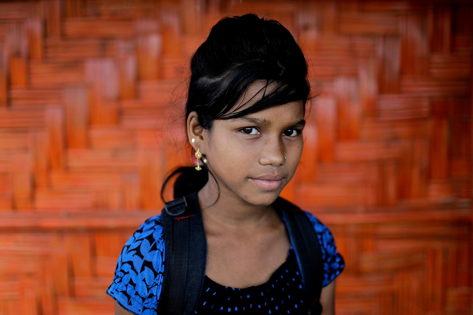 Astafa poses for a portrait in front of her classroom in Chakmarkul refugee camp, Bangladesh.  (AP Photo/Wong Maye-E)