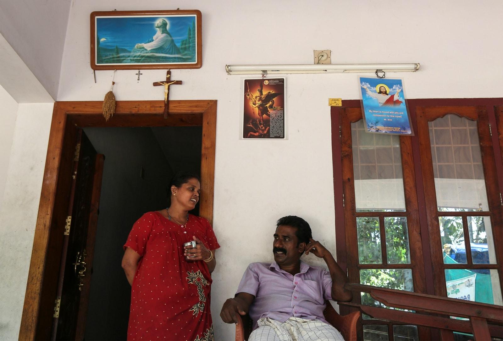 Farmer, Joby Pathrose speaks to his wife Kavitha at their house in Okkal village in Ernakulam, Kerala, India. September 25, 2018. REUTERS/Sivaram V