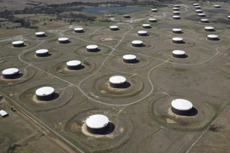 US oil edges up after 3 percent drop on big stock build