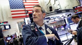 Wall Street sinks as Amazon, Alphabet earnings spark growth concerns