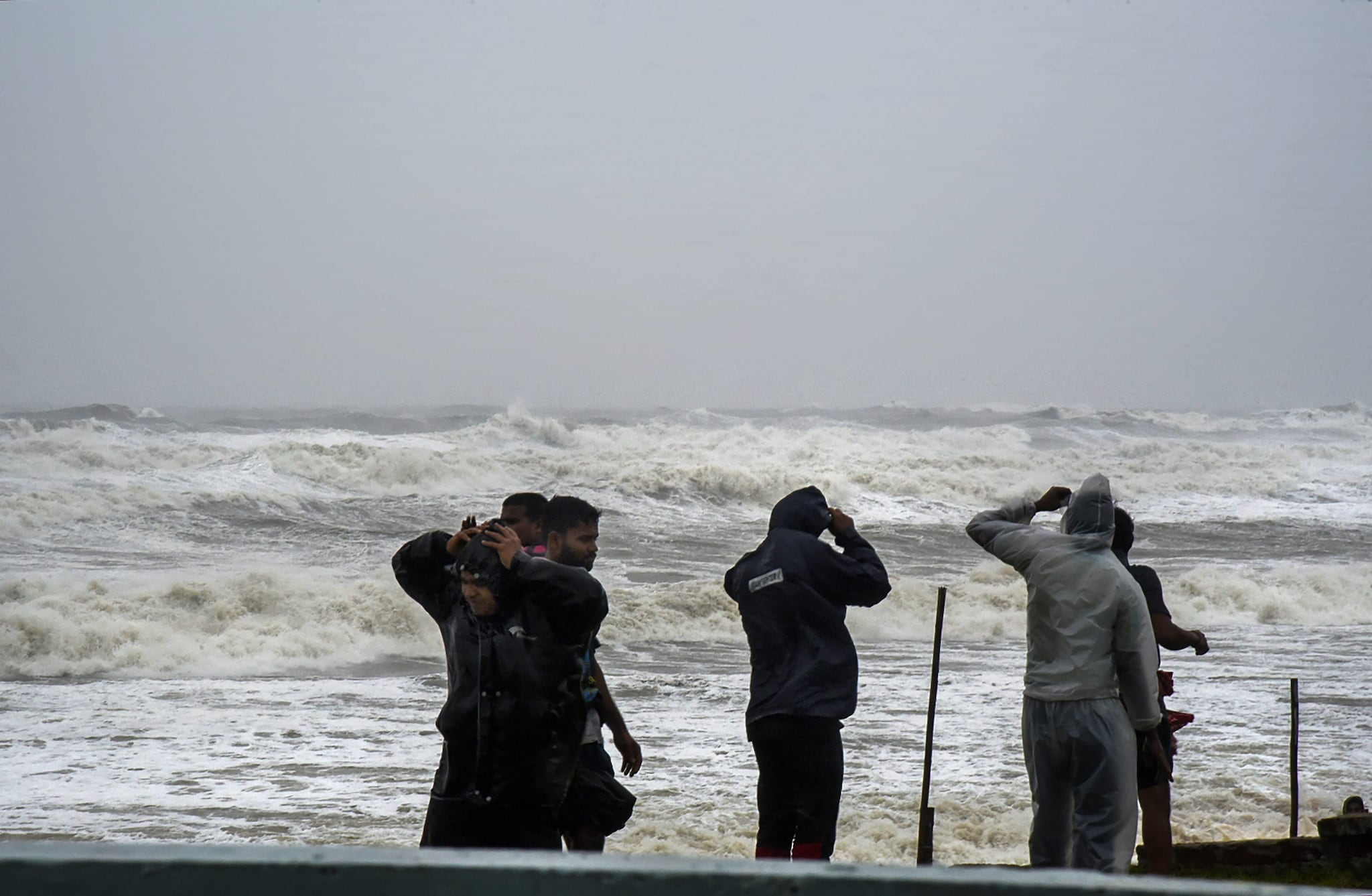 Ganjam: People look on as Cyclone Titli hits the city, starting with surface wind effect reaching speeds of 126 kmph at Gopalpur, in Ganjam, Thursday, Oct 11, 2018. (PTI)