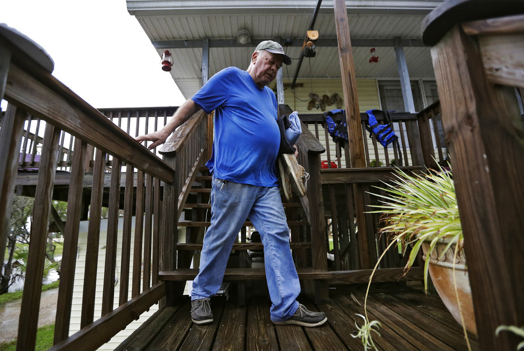 Cornell Silveira, of Keaton Beach, Fla., leaves with some of his belongings as he evacuates his home as Hurricane Michael approaches the area Wednesday, October 10, 2018. Hurricane Michael continues to churn in the Gulf of Mexico heading for the Florida panhandle. (AP Photo/Chris O'Meara)