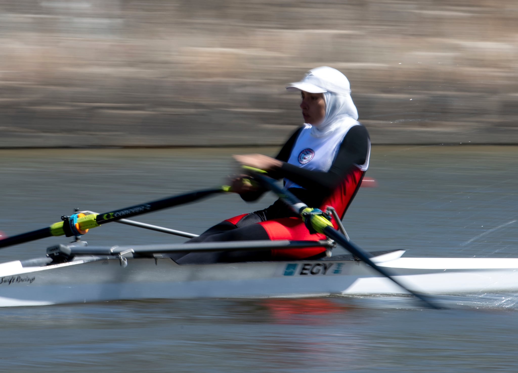 Dareen Mahmoud Mohamed from Egypt, rows in EGY in the round 6 final E race in the rowing women's single sculls at Diques Puerto Madero, during the Youth Olympic Summer Games in Buenos Aires, Argentina, Wednesday, Oct. 10, 2018. (Jonathan Nackstrand/OIS/IOC via AP)