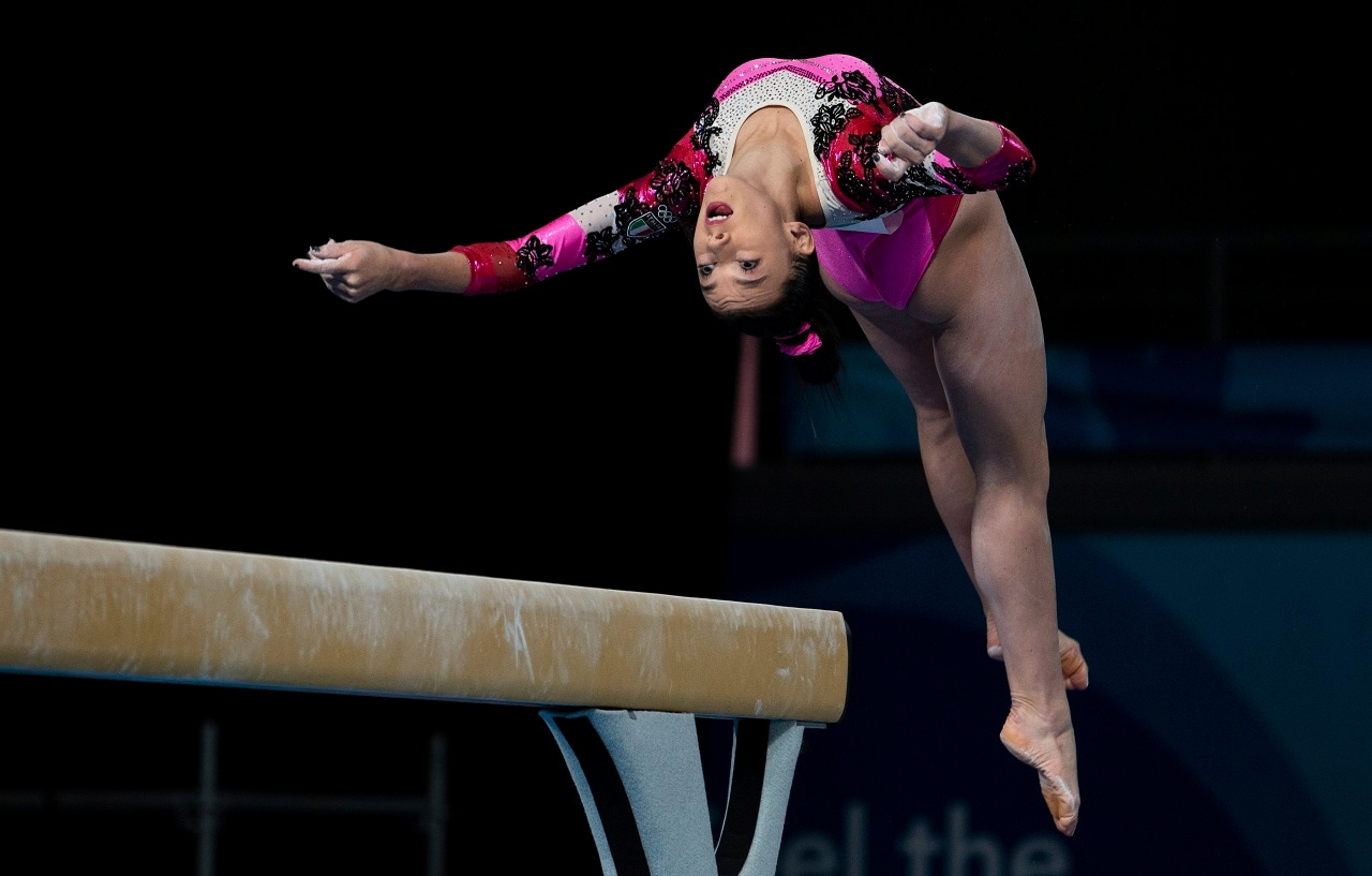 In this photo provided by the OIS/IOC, Italy's Giorgia Villa competes in the Women's Artistic Balance Beam Gymnastics qualification in Youth Olympic Park at the Youth Olympic Games in Buenos Aires, Argentina, Wednesday, Oct. 10, 2018. (Ivo Gonzalez/OIS/IOC via AP)