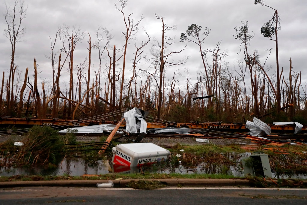 Shredded trees, derailed train cars and a sunken trailer are seen in the aftermath of Hurricane Michael in Panama City, Fla., Wednesday, October 10, 2018. (AP Photo/Gerald Herbert)
