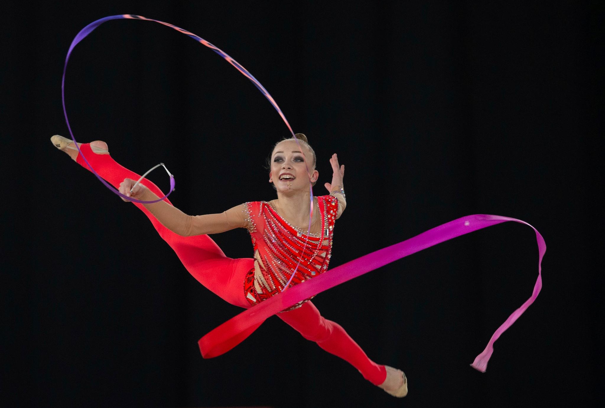 In this photo provided by the OIS/IOC, Ukraine's Khrystyna Pohranychna, with Team Dong Dong, competes in the Rhythmic Gymnastics Ribbon Routine during the Gymnastic Multi-Discipline Team event in Youth Olympic Park at the Youth Olympic Games in Buenos Aires, Argentina, Wednesday, Oct. 10, 2018. (Ivo Gonzalez/OIS/IOC via AP)