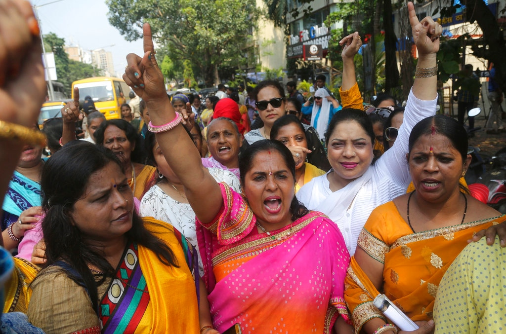 Activists of Congress party's women's wing shout slogans against Bollywood actor Nana Patekar during a protest in support of former Bollywood actress Tanushree Dutta in Mumbai, India,  A social media storm began in September, when Dutta spoke to several Indian TV news channels about her frustration with nothing resulting from a police complaint she filed in 2008 against Patekar for alleged sexual harassment on a Mumbai movie set. The complaint by the retired actress living in the United States could be a tipping point for the country's burgeoning #MeToo movement. Thursday, Oct.11, 2018. (AP Photo/Rafiq Maqbool)