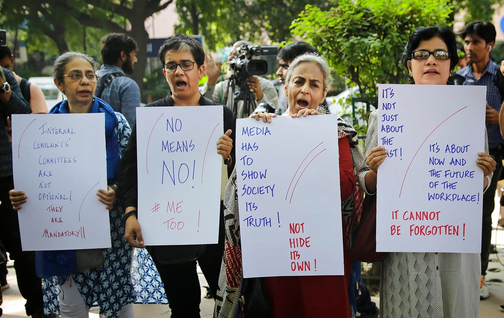 Journalists hold placards as they shout slogans during a protest against sexual harassment in the workplace in New Delhi, India. Saturday, Oct. 13, 2018. (AP Photo/Altaf Qadri)