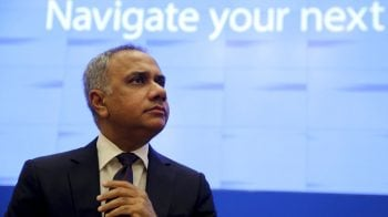 Infosys shares erase early losses, rise nearly 2%