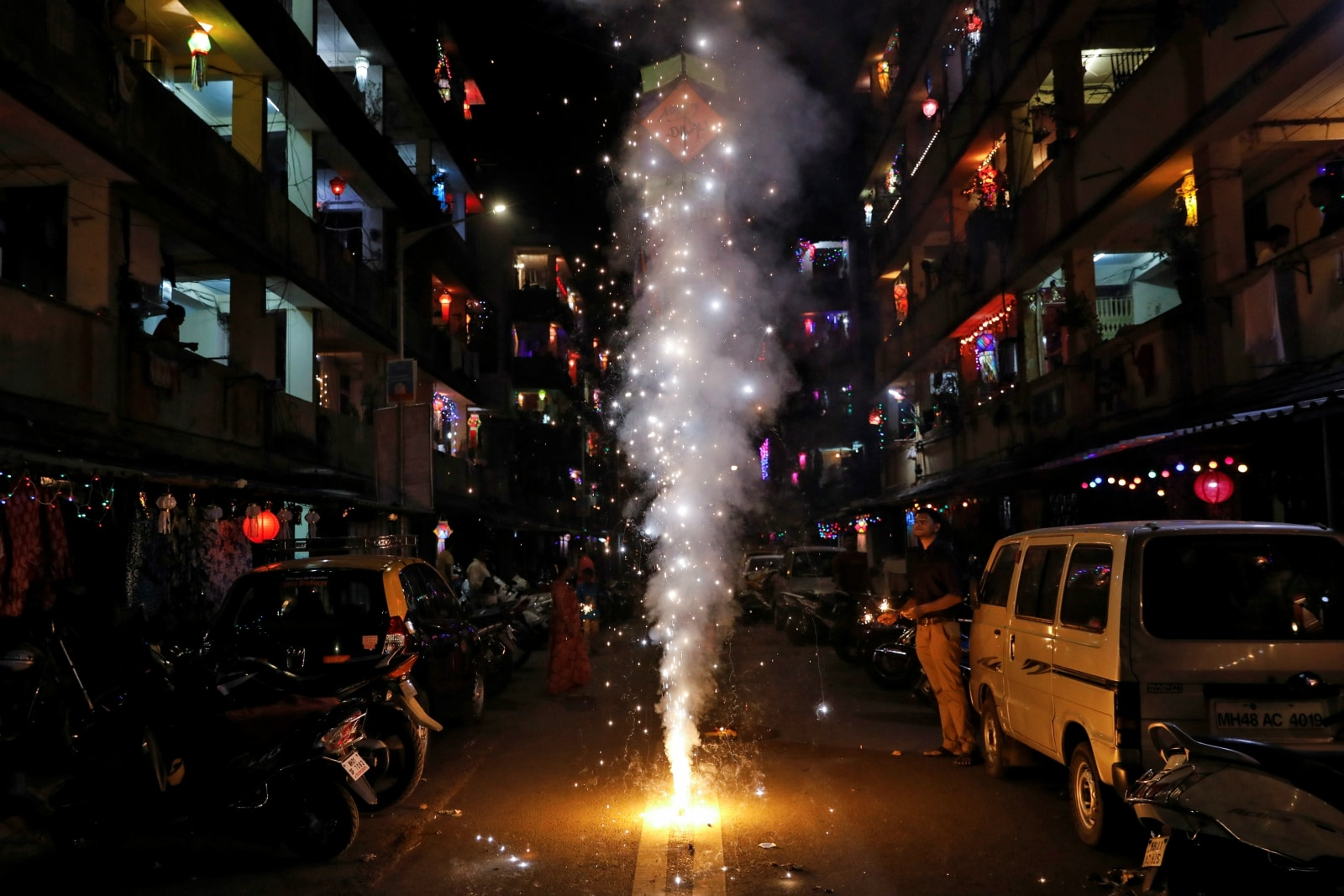 A man lights a firecracker while celebrating the Hindu festival of Diwali, the annual festival of lights in Mumbai, India, November 7, 2018. REUTERS/Danish Siddiqui