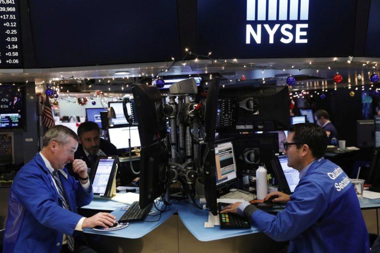 Wall Street climbs as financials snap five days of losses