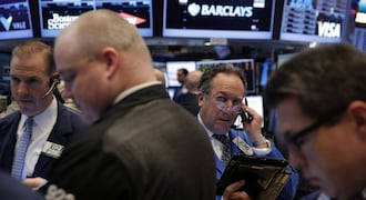 Wall Street slips as energy drops, investors digest US Fed comments